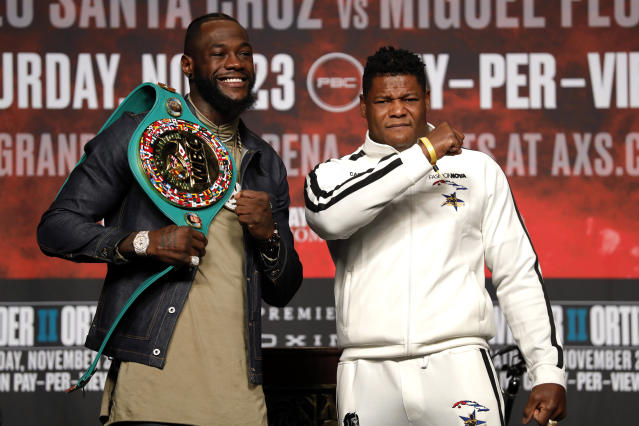 WBC heavyweight champion Deontay Wilder, left, and Luis Ortiz pose during a final news conference at MGM Grand Garden Arena in Las Vegas Wednesday, Nov. 20, 2019. The boxers will have a rematch at the arena on Saturday, Nov. 23, 2019. (Steve Marcus/Las Vegas Sun via AP)