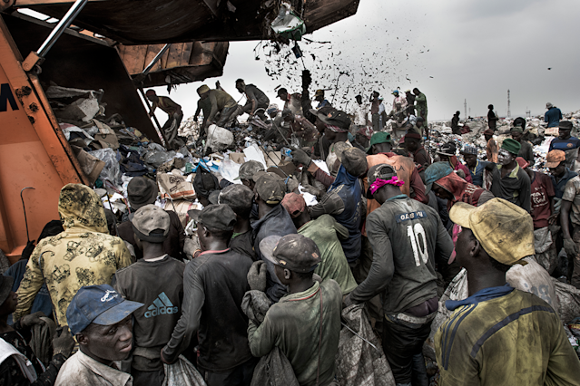 <p>Wasteland: People wait to sort through waste for recyclable and saleable material, as a garbage truck arrives at the Olusosun landfill, in Lagos, Nigeria, Jan. 21, 2017.<br>Humans are producing more waste than ever before. According to research by the World Bank, the world generates 3.5 million tonnes of solid waste a day, ten times the amount of a century ago. Rising population numbers and increasing economic prosperity fuel the growth, and as countries become richer, the composition of their waste changes to include more packaging, electronic components and broken appliances, and less organic matter. Landfills and waste dumps are filling up, and the World Economic Forum reports that by 2050 there will be so much plastic floating in the world's oceans that it will outweigh the fish. A documentation of waste management systems in metropolises across the world investigates how different societies manage — or mismanage — their waste. (Photo: Kadir van Lohuizen/NOOR Images) </p>