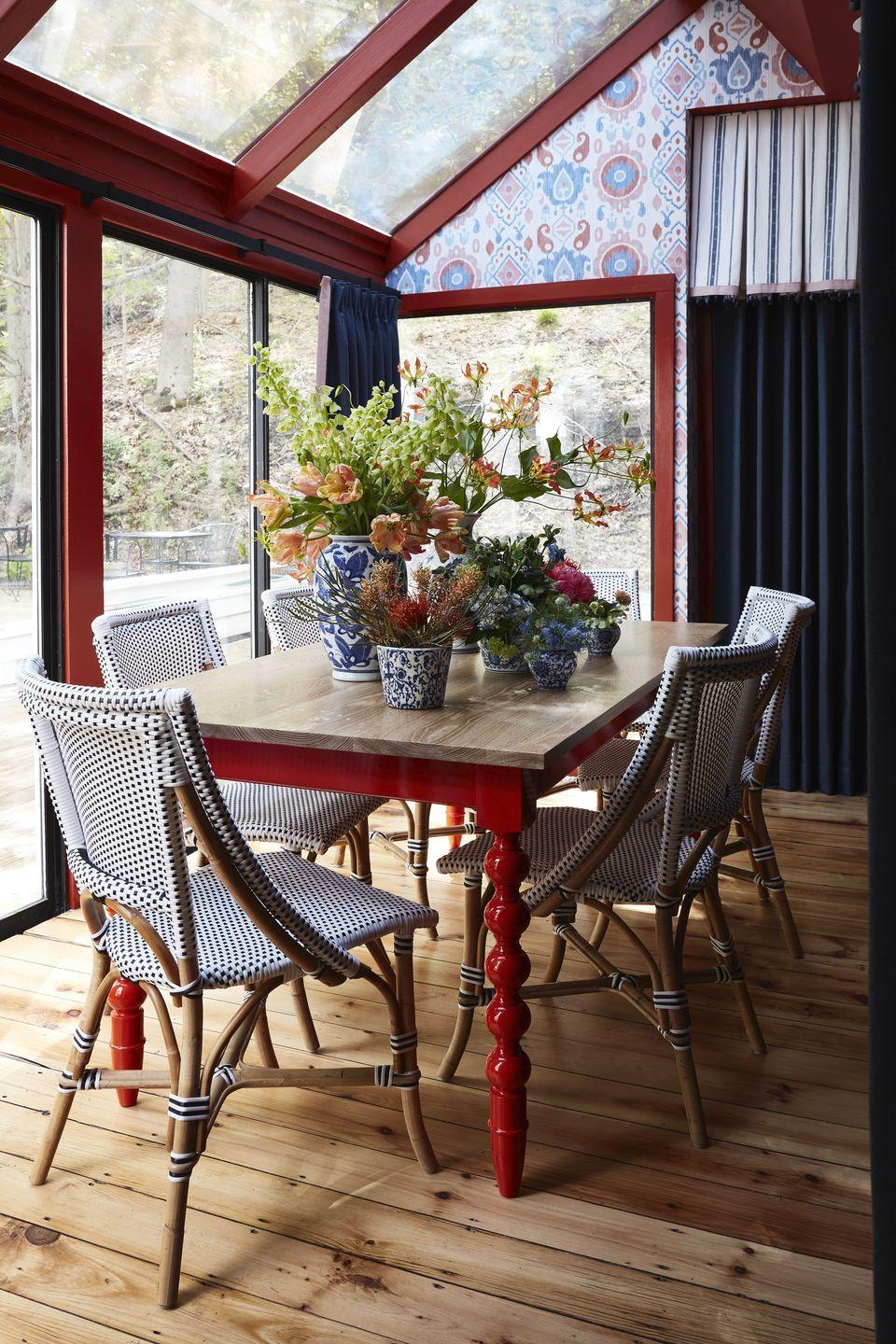 """<p>A key element in this dining room by Virginia Toledo of the firm <a href=""""http://toledogeller.com/"""" rel=""""nofollow noopener"""" target=""""_blank"""" data-ylk=""""slk:Toledo Geller"""" class=""""link rapid-noclick-resp"""">Toledo Geller</a> is the red-legged communal dining table—<em>comparte</em> means """"to share"""" in Spanish. """"I smile thinking about the friendships that might be forged between guests that decided to share a meal together in the dining room I designed,"""" she told us. The red, white, and blue Eliza Ikat wallpaper from <a href=""""https://fschumacher.com/"""" rel=""""nofollow noopener"""" target=""""_blank"""" data-ylk=""""slk:Schumacher"""" class=""""link rapid-noclick-resp"""">Schumacher</a> is a twist on classic Americana, according to the designer: """"It felt native to the inn and its New England location, but the color palette is used in a globally inspired pattern."""" Toledo felt it was exactly what the Kaleidoscope Project represents, the diverse backgrounds """"that make up the fabric of America.""""<br></p>"""