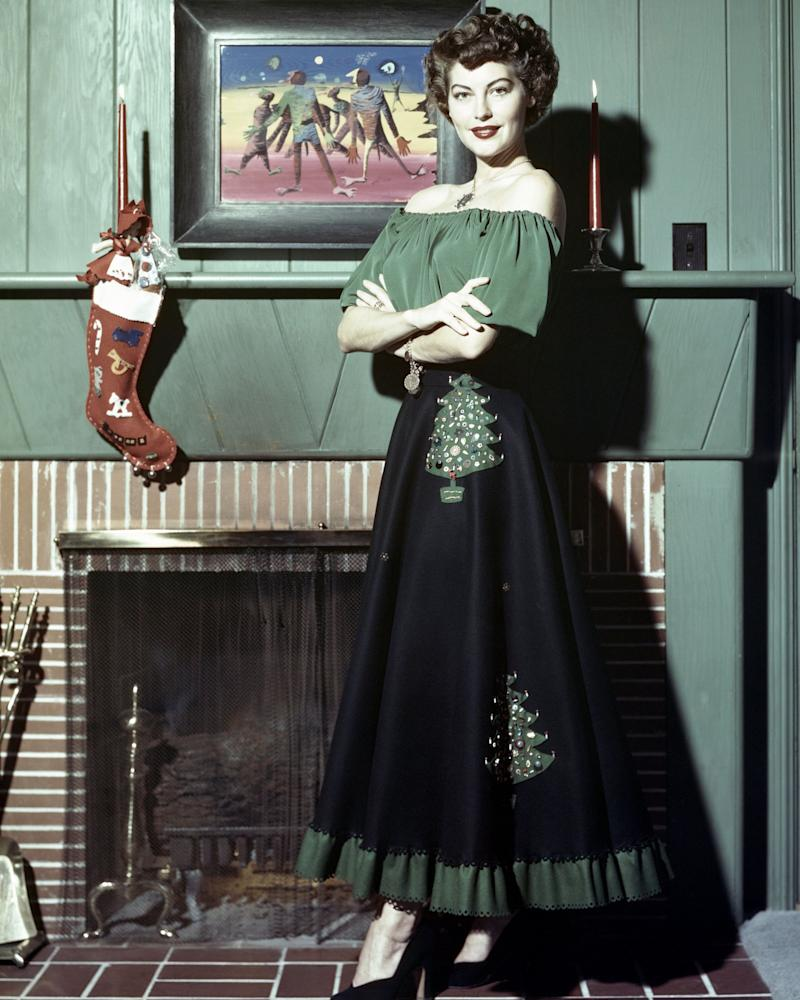 Ava Gardner was a star of classic Hollywood cinema, so it's fitting that her fashion was always classic, too. This could have been a Christmas card, or an advertisement for a fireplace — who knows. What matters is that this skirt, bedecked with bejewelled trees, is perfect.