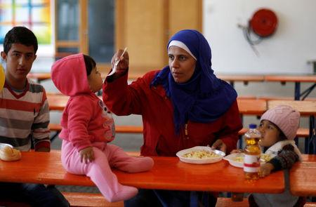 FILE PHOTO: A  woman from Syria feeds her baby at a refugee centre in Hamm, Germany, September 7, 2015. REUTERS/Ina Fassbender/File Photo