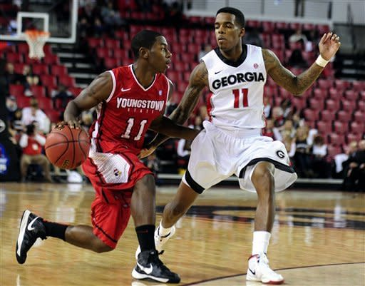 Georgia's Vincent Williams (11) guards Youngstown State's DJ Cole (11) during an NCAA college basketball game on Monday, Nov. 12, 2012, in Athens, Ga. Youngstown won 68-56. (AP Photo/Athens Banner-Herald, Richard Hamm)