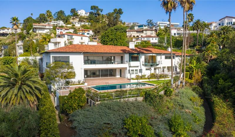 The gated estate holds a 1950s home, two guest suites and a swimming pool with a diving board.
