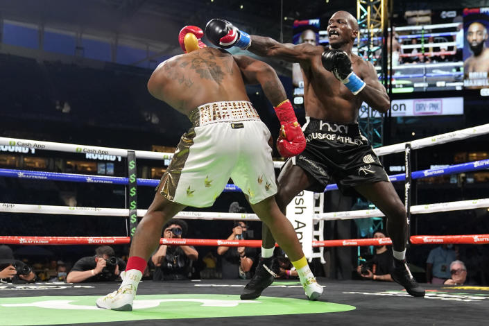 Former NFL wide receiver Chad Johnson, right, fights Brian Maxwell during an exhibition boxing match at Hard Rock Stadium, Sunday, June 6, 2021, in Miami Gardens, Fla. (AP Photo/Lynne Sladky)