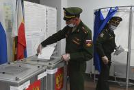 Russian officers vote at a polling station during the Parliamentary elections in Rostov-on-Don, Russia, Friday, Sept. 17, 2021. Russia has begun three days of voting for a new parliament that is unlikely to change the country's political complexion. There's no expectation that United Russia, the party devoted to President Vladimir Putin, will lose its dominance in the State Duma. (AP Photo)