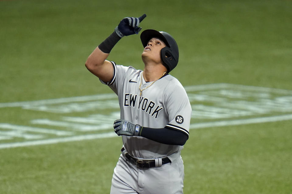 New York Yankees' Gio Urshela celebrates after his two-run home run off Tampa Bay Rays starting pitcher Michael Wacha during the third inning of a baseball game Sunday, April 11, 2021, in St. Petersburg, Fla. (AP Photo/Chris O'Meara)