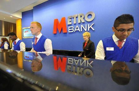 Staff serve customers at the first branch of  Metro Bank in Holborn in central London