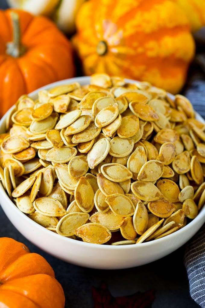 "<p>There's nothing better than noshing on crispy, crunchy, and flavorful pumpkin seeds. These satisfying seeds are high in both protein and fiber, and they contain healthy nutrients such as manganese, iron, and zinc. Bake them until they're golden brown, and enjoy them all season long.</p> <p><strong>Get the recipe:</strong> <a href=""https://www.dinneratthezoo.com/roasted-pumpkin-seeds/?utm_source=feedburner&utm_medium=feed&utm_campaign=Feed%3A+dinneratthezoo+%28Dinner+at+the+Zoo%29"" class=""link rapid-noclick-resp"" rel=""nofollow noopener"" target=""_blank"" data-ylk=""slk:roasted pumpkin seeds"">roasted pumpkin seeds</a></p>"