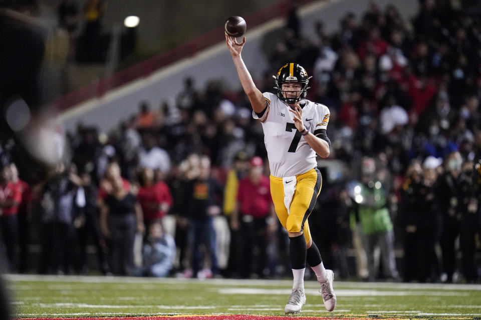 Iowa quarterback Spencer Petras throws a pass against Maryland during the first half of an NCAA college football game, Friday, Oct. 1, 2021, in College Park, Md. (AP Photo/Julio Cortez)
