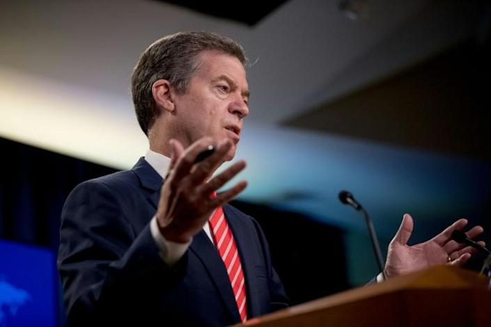 Sam Brownback, US ambassador at large for international religious freedom, seen speaking in June 2020, has sharply criticized China's embassy for promoting population policies involving Uighur women