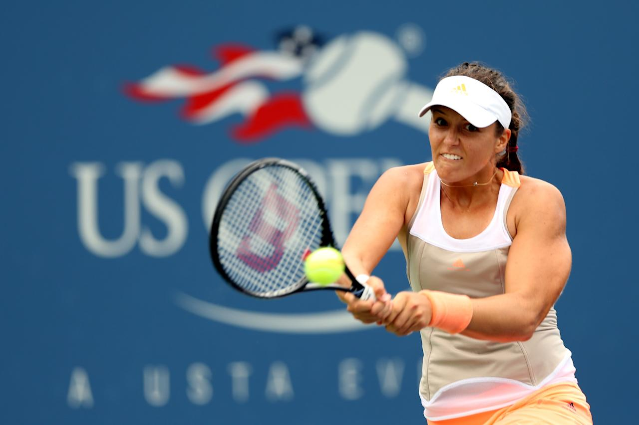 NEW YORK, NY - AUGUST 26: Laura Robson of Great Britain returns a shot to Lourdes Dominguez Lino of Spain during their first round women's singles match on Day One of the 2013 US Open at USTA Billie Jean King National Tennis Center on August 26, 2013 in the Flushing neigborhood of the Queens borough of New York City. (Photo by Matthew Stockman/Getty Images)
