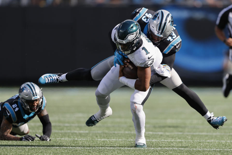 Philadelphia Eagles quarterback Jalen Hurts is tackled by Carolina Panthers outside linebacker Haason Reddick during the second half of an NFL football game Sunday, Oct. 10, 2021, in Charlotte, N.C. (AP Photo/Nell Redmond)