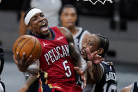 New Orleans Pelicans guard Eric Bledsoe (5) drives to the basket past San Antonio Spurs forward DeMar DeRozan (10) during the second half of an NBA basketball game in San Antonio, Saturday, Feb. 27, 2021. (AP Photo/Eric Gay)