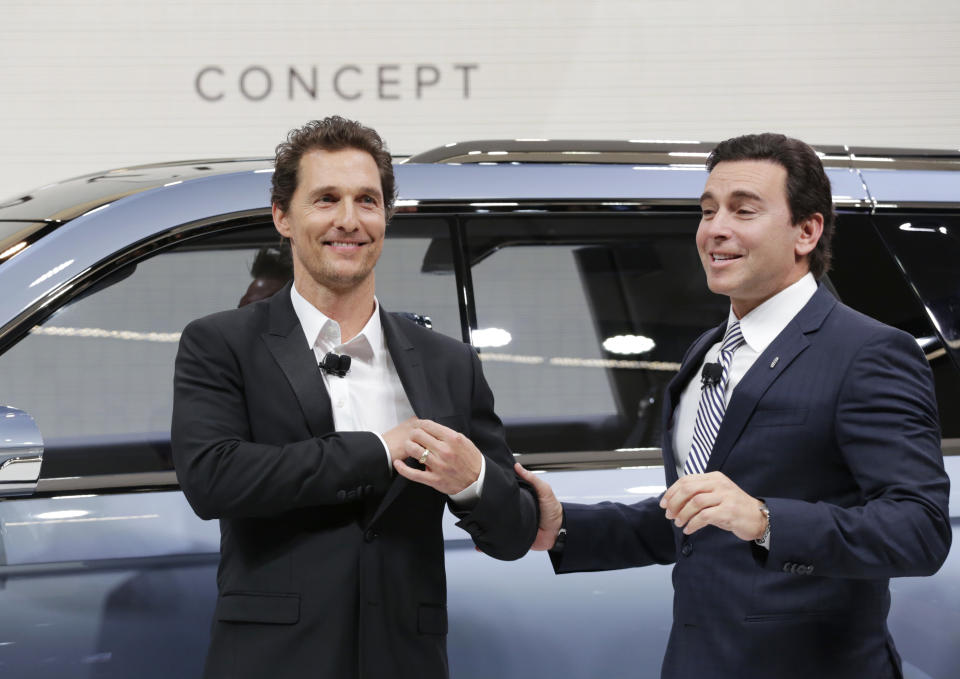 Actor Matthew McConaughey, left, and Ford CEO Mark Fields introduce the Lincoln Navigator Concept at the New York International Auto Show, Wednesday, March 23, 2016. (AP Photo/Mark Lennihan)