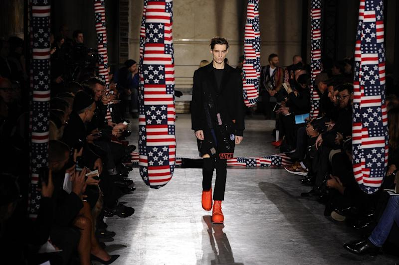A model presents a creation as part of Raf Simons and Sterling Ruby's men's Fall-Winter 2014-2015 fashion collection, presented Wednesday, Jan. 15, 2014 in Paris. (AP Photo/Zacharie Scheurer)