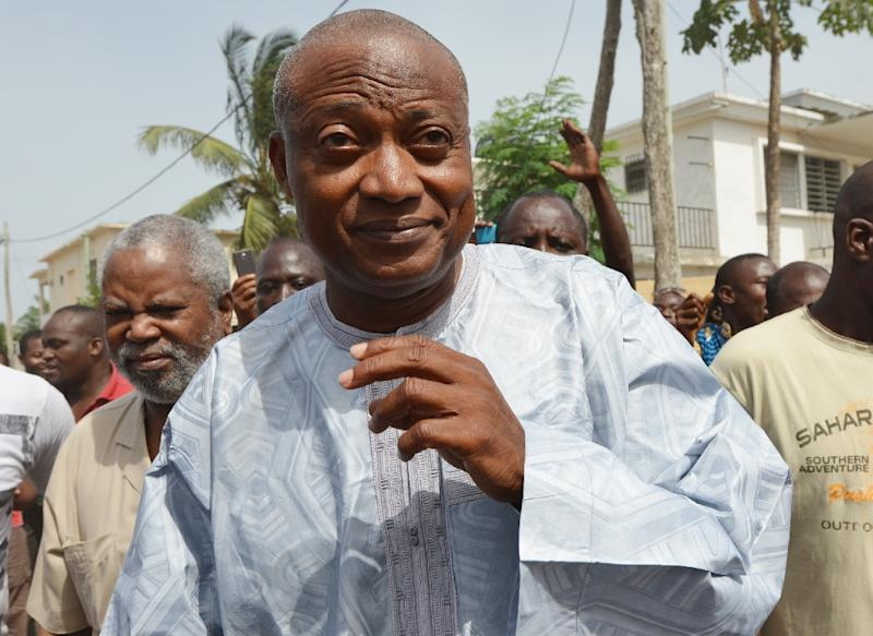 Togo opposition leader Jean-Pierre Fabre arrives at a polling station before voting for the presidential election in the capital Lome on April 25, 2015 (AFP Photo/Issouf Sanogo)