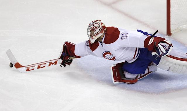 Montreal Canadiens goalie Carey Price stretches from the crease to turn the puck away, against the Boston Bruins during the third period in Game 7 of a second-round NHL hockey Stanley Cup playoff series in Boston, Wednesday, May 14, 2014. (AP Photo)