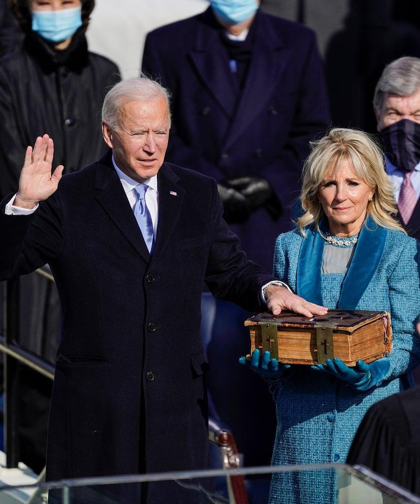 Washington , DC – January 20: U.S. President-elect Joe Biden takes the oath of office from Supreme Court Chief Justice John Roberts as his wife U.S. First Lady-elect Jill Biden stands next to him during the 59th presidential inauguration in Washington, D.C. on Wednesday, Jan. 20, 2021. . (Kent Nishimura / Los Angeles Times via Getty Images)