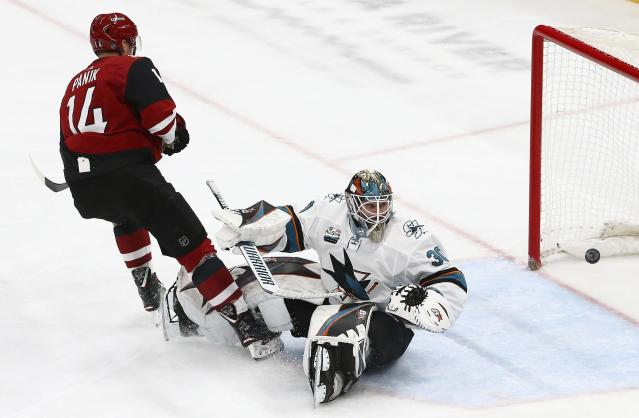 Arizona Coyotes right wing Richard Panik (14) scores a goal against San Jose Sharks goaltender Aaron Dell (30) during the first period of an NHL hockey game Wednesday, Jan. 16, 2019, in Glendale, Ariz. (AP Photo/Ross D. Franklin)