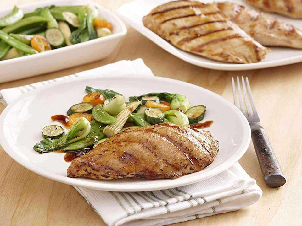 """<p>The trick to mastering a delicious stir-fry is to cook the meat separately for a tasty, charred flavor. Combine soy sauce, brown sugar, sherry, sesame oil, garlic and ginger for a tangy marinade and pour the remaining mixture over your grilled vegetables. <a href=""""https://www.thedailymeal.com/cook/25-rice-dishes-will-make-you-forget-potatoes-slideshow?referrer=yahoo&category=beauty_food&include_utm=1&utm_medium=referral&utm_source=yahoo&utm_campaign=feed"""" rel=""""nofollow noopener"""" target=""""_blank"""" data-ylk=""""slk:Serve with a side of rice for a delicious, hearty dinner"""" class=""""link rapid-noclick-resp"""">Serve with a side of rice for a delicious, hearty dinner</a>. </p> <p><a href=""""https://www.thedailymeal.com/best-recipes/grilled-chicken-ginger-garlic-asian?referrer=yahoo&category=beauty_food&include_utm=1&utm_medium=referral&utm_source=yahoo&utm_campaign=feed"""" rel=""""nofollow noopener"""" target=""""_blank"""" data-ylk=""""slk:For the Ginger Garlic Asian Grilled Chicken recipe, click here."""" class=""""link rapid-noclick-resp"""">For the Ginger Garlic Asian Grilled Chicken recipe, click here.</a></p>"""