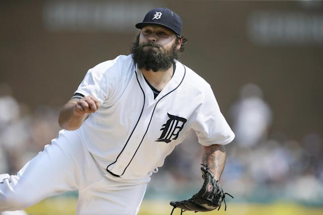 In a photo from July 20, 2014, Detroit Tigers relief pitcher Joba Chamberlain follows through on a throw during the eighth inning of a baseball game against the Cleveland Indians in Detroit. Chamberlain has been the exception in the Tigers' bullpen. While most of his fellow relievers have been shaky, the former New York Yankee has been solid all season and simply sensational lately for the AL Central leaders. (AP Photo/Carlos Osorio)