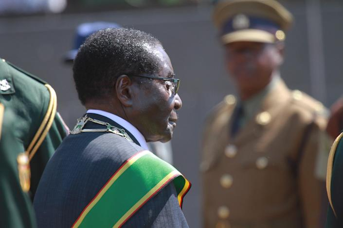 Zimbabwean President elect Robert Mugabe at the country's Commemoration of Heroes day in Harare, Zimbabwe Monday, Aug. 12, 2013. Mugabe received more than 60 percent of the vote in just-ended Presidential elections while his main challenger Morgan Tsvangirai is challenging the results in court and declaring the election null and void. (AP Photo/Tsvangirayi Mukwazhi)