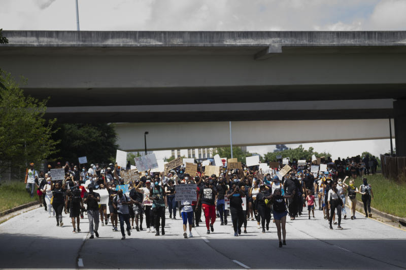 Activists march toward the downtown Connector freeway, Monday, June 1, 2020, in Atlanta. The protesters were demonstrating against the the killing of George Floyd by police in Minnesota which has sparked worldwide protests and rioting nationwide. (John Amis/Atlanta Journal-Constitution via AP)