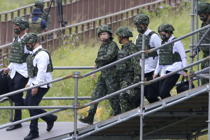 Taiwanese President Tsai Ing-wen, center, walks with officials after attending the 36th Han Kung military exercises in Taichung City, central Taiwan, Thursday, July 16, 2020. Taiwan's military fired missiles from the air and the island's shore facing China on Thursday in a live-fire exercise to demonstrate its ability to defend against any Chinese invasion. (AP Photo/Chiang Ying-ying)