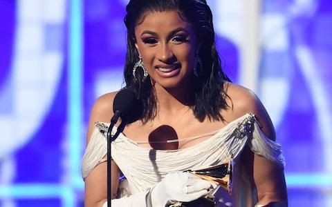 "Cardi B accepts the award for Best Rap Album with ""Invasion Of Privacy"" onstage during the 61st Annual Grammy Awards on February 10, 2019, in Los Angeles - Credit: AFP"
