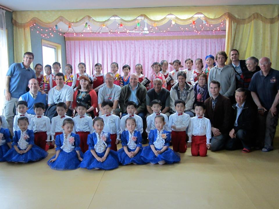 Our group poses with a class at the Mangyongdae Children's Palace, attended by the offspring of the elite. They have just performed a little song and dance for us. Kids in all the schools we visit spend much of their time in gymnastics, musical performances, or mass games. Classroom time is taken up with heroic deeds from the lives and Great Leader and the Dear Leader. Contrast this with South Korean primary school kids the same age, who by now are proficient in languages, math, and science.