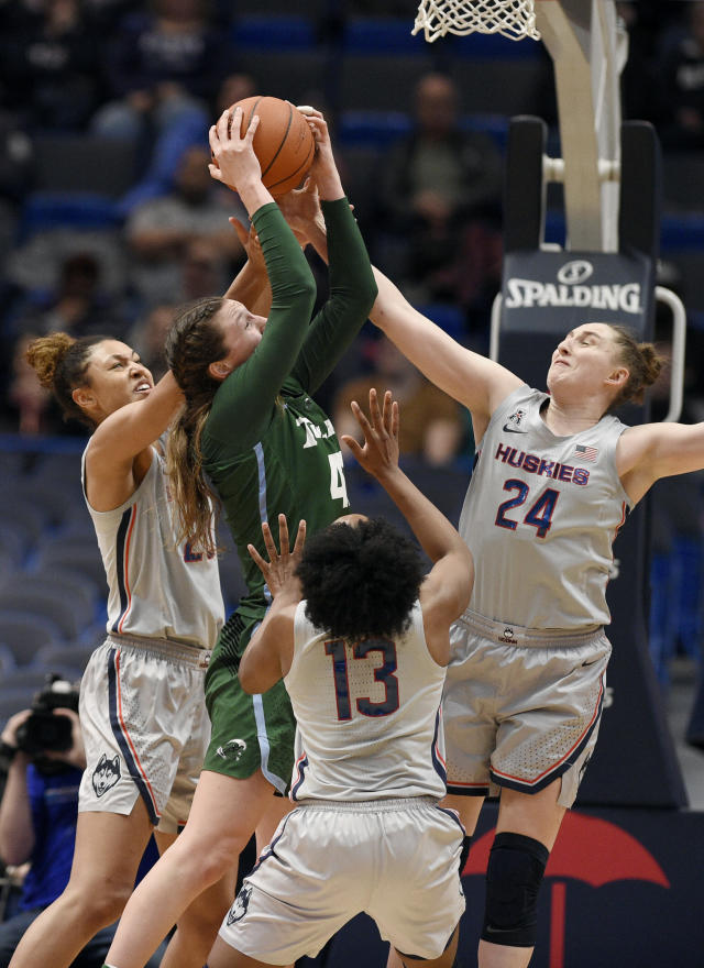 Connecticut's Olivia Nelson-Ododa, left, Connecticut's Christyn Williams center, and Connecticut's Anna Makurat, right, pressure Tulane's Mia Heide as she shoots in the second half of an NCAA college basketball game, Wednesday, Feb. 19, 2020, in Hartford, Conn. (AP Photo/Jessica Hill)