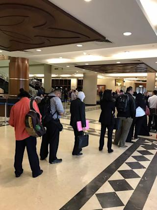 The queue for e-filing as seen at 7.56am on June 22, 2017, stretching past the reception desk and main glass doors at the KL court complex. — Picture by a Malay Mail Online reader