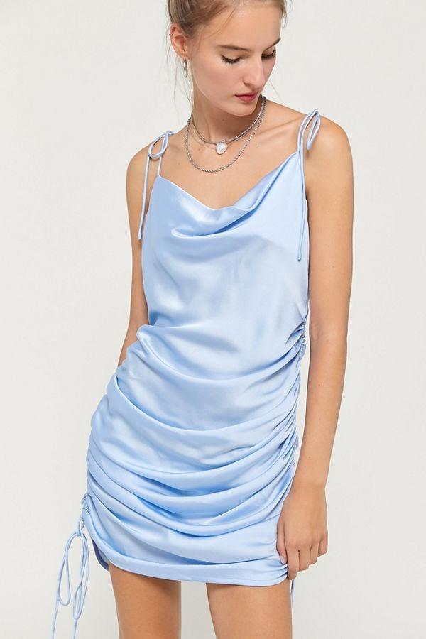 """<p>This <a href=""""https://www.popsugar.com/buy/Lioness-String-Along-Satin-Cinched-Dress-517817?p_name=Lioness%20String%20Along%20Satin%20Cinched%20Dress&retailer=urbanoutfitters.com&pid=517817&price=79&evar1=fab%3Aus&evar9=46901824&evar98=https%3A%2F%2Fwww.popsugar.com%2Fphoto-gallery%2F46901824%2Fimage%2F46901840%2FLioness-String-Along-Satin-Cinched-Dress&list1=shopping%2Cdresses%2Cparty%20dresses%2Cwinter%2Cnew%20years%20eve%2Cnew%20year%2Cwinter%20fashion&prop13=api&pdata=1"""" rel=""""nofollow"""" data-shoppable-link=""""1"""" target=""""_blank"""" class=""""ga-track"""" data-ga-category=""""Related"""" data-ga-label=""""https://www.urbanoutfitters.com/shop/lioness-string-along-satin-cinched-dress?category=party-dresses&amp;color=040&amp;quantity=1&amp;type=REGULAR"""" data-ga-action=""""In-Line Links"""">Lioness String Along Satin Cinched Dress</a> ($79) is so sexy.</p>"""