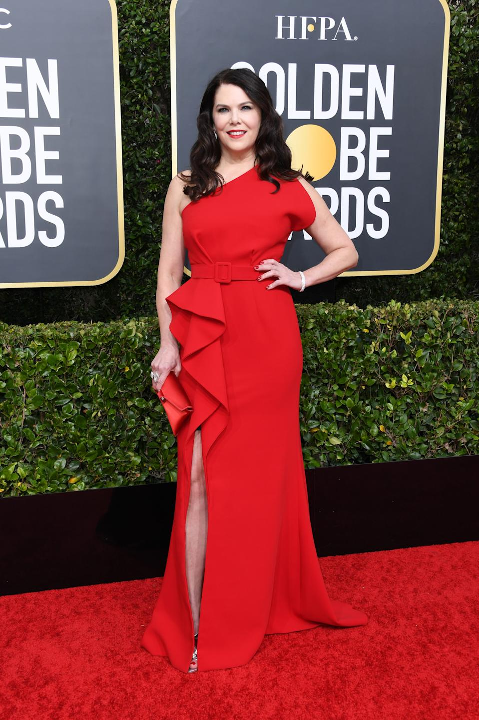 """The """"Gilmore Girls"""" star wowed in a belted red gown with ruffled accents. (Photo by Jon Kopaloff/Getty Images)"""