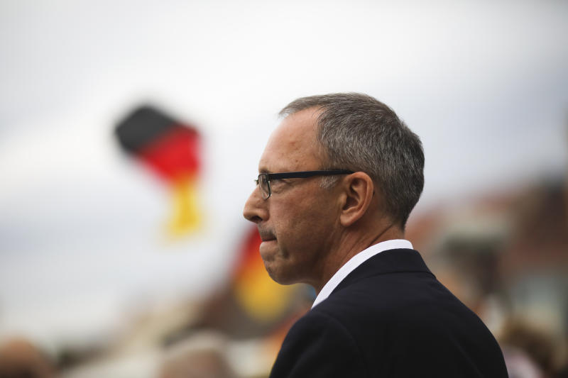 In this Thursday, Aug. 15, 2019 photo, Joerg Urban, top candidate of German Alternative for Germany, AfD, party for the Saxony state elections, attend an election campaign rally of his party in Bautzen, Germany. Two elections in eastern Germany's states Brandenburg and Saxony on Sept. 1, 2019, look set to bring big gains for the far-right Alternative for Germany party and another blow to the traditional parties that form the national government. (AP Photo/Markus Schreiber)