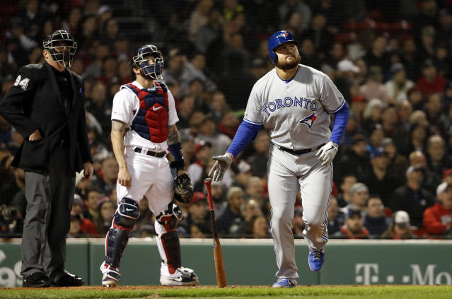 Toronto Blue Jays' Rowdy Tellez watches his two-run home run next to Boston Red Sox catcher Blake Swihart and umpire Lance Barrett during the third inning of a baseball game Thursday, April 11, 2019, at Fenway Park in Boston. (AP Photo/Winslow Townson)