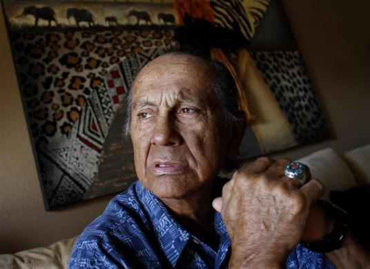 American Indian activist Russell Means poses for a portrait at his home in Scottsdale, Arizona, October 28, 2011. Means is used to battles, having faced off against the U.S. government early and often throughout his high-profile life. Now the controversial former leader of the American Indian Movement is engaged in a different fight -- against advanced esophageal cancer. To match story PEOPLE-MEANS/   REUTERS/Joshua Lott (UNITED STATES - Tags: SOCIETY POLITICS HEALTH)