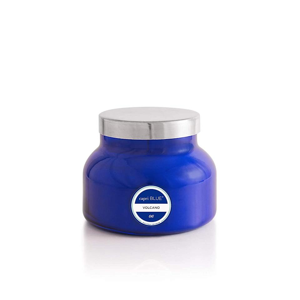 """Tbh, this should be on one of those Forbes Worth Every Penny lists. Nothing beats the smell of a relaxing candle after being on your feet for 12 (let's be real, 13–14 hours) as a nurse. Capri Blue describes it as """"iconic notes of tropical fruit and sugared citrus."""" But I describe it as """"the best-smelling candle I have ever smelled."""" Great for use with a bubble bath, for relaxation time, or literally for all of the time. Kind of one of those things that you might not want to splurge on for yourself, so that makes this an excellent gift. Long-lasting and v fragrant. 10/10 would recommend. <em>—Jordan Humphries, R.N., B.S.N. coronary care unit/home infusion</em> $30, Capri Blue. <a href=""""https://shop-links.co/1722209800584734203"""" rel=""""nofollow noopener"""" target=""""_blank"""" data-ylk=""""slk:Get it now!"""" class=""""link rapid-noclick-resp"""">Get it now!</a>"""