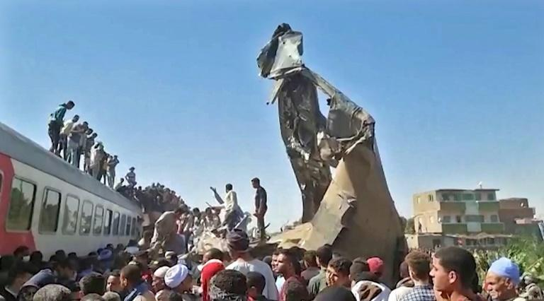 Twisted metal juts from the wreckage of a train collision that killed at least 32 people and injured more than 160 in southern Egypt