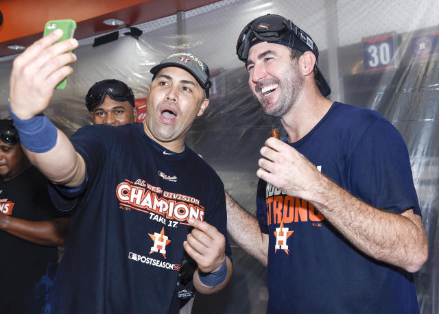 "Carlos Beltran celebrates the Astros' World Series win with <a class=""link rapid-noclick-resp"" href=""/mlb/players/7590/"" data-ylk=""slk:Justin Verlander"">Justin Verlander</a>. (AP)"