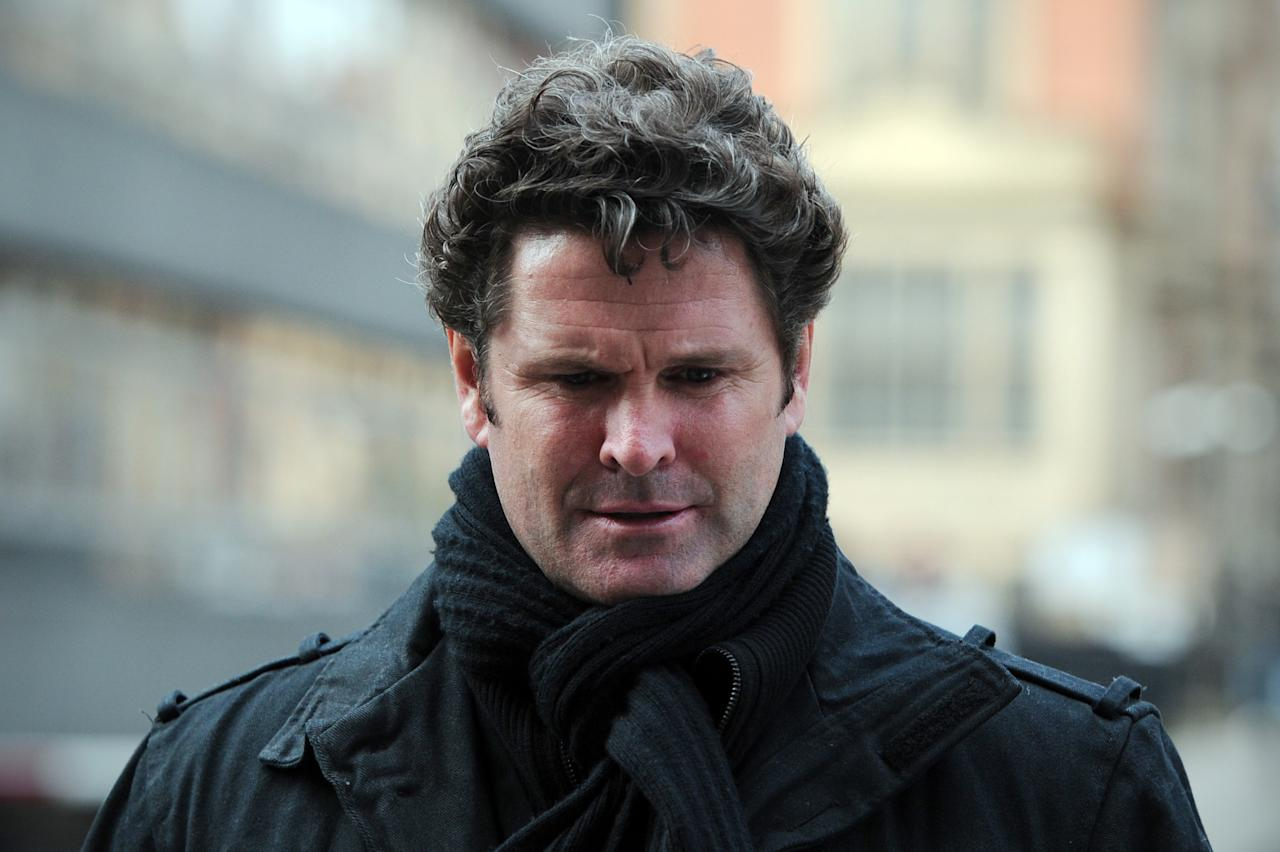"Former New Zealand cricketer, Chris Cairns, returns to the High Court in central London on March 05, 2012, after a lunch break in a hearing in a libel case he has brought against ex-chairman of India's cricket IPL Lalit Modi. Former New Zealand cricket captain Cairns asked the High Court for substantial libel damages over an accusation of match-fixing which had turned his achievements to ""dust"". Cairns, 41, who notched up the rare double of 200 wickets and 3,000 runs in his 62 Tests, is suing Lalit Modi, ex-chairman of Twenty20 franchise the Indian Premier League (IPL) over an ""unequivocal allegation"" on Twitter.  AFP PHOTO / CARL COURT (Photo credit should read CARL COURT/AFP/Getty Images)"