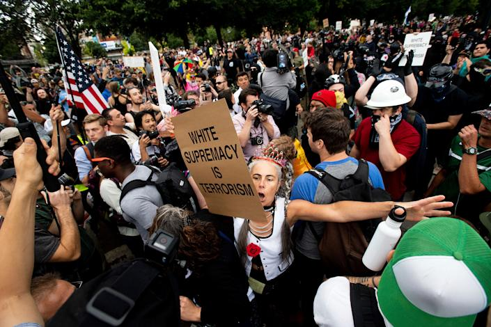 """A counter-protester confronts members of the Proud Boys and other right-wing demonstrators during an """"End Domestic Terrorism"""" rally in Portland, Ore., on Saturday, Aug. 17, 2019."""