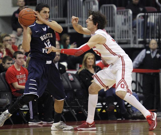 North Florida's Aaaron Bodager, left, looks for an open pass as Ohio State's Amadeo Della Valle defends during the first half of an NCAA college basketball game on Friday, Nov. 29, 2013, in Columbus, Ohio. (AP Photo/Jay LaPrete)