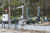 An XTO Energy natural gas fracking well pad is seen in Freeport, Pennsylvania, on Thursday, Oct. 15, 2020. President Trump accuses Joe Biden of wanting to ban fracking, a sensitive topic in the No. 2 natural gas state behind Texas. Biden insists he does not want to ban fracking broadly - he wants to ban it on federal lands and make electricity production fossil-fuel free by 2035. (AP Photo/Ted Shaffrey)