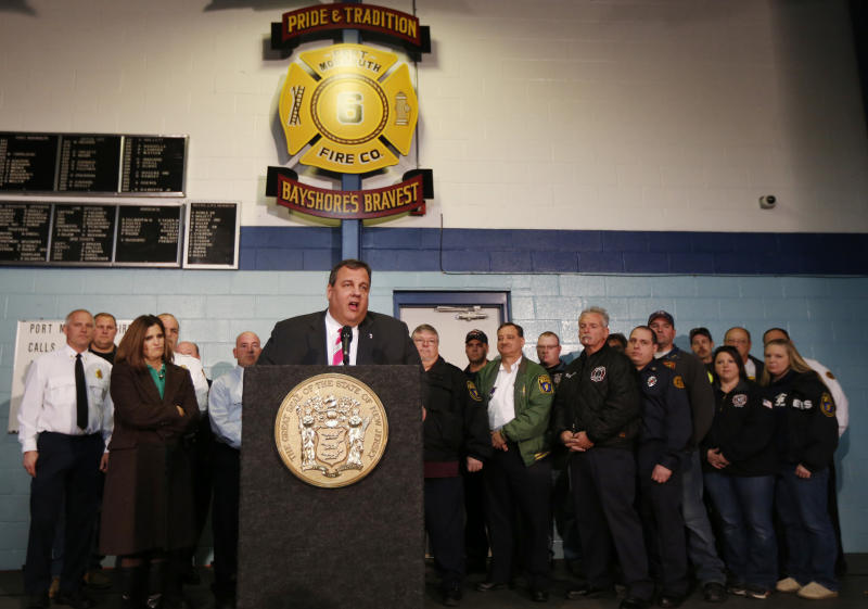 """New Jersey Gov. Chris Christie, center, talks during a news conference at at fire house, Monday, Nov. 26, 2012, in Middletown, N.J. Christie announced he will seek re-election to a second term. Christie says he want New Jerseyans to know that he's """"in this for the long haul"""" as he leads the state's recovery from Superstorm Sandy. (AP Photo/Julio Cortez)"""