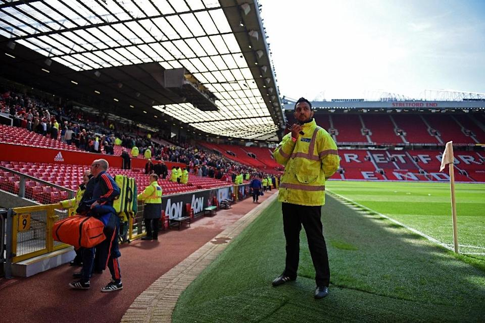 Fans are evacuated from Old Trafford stadium in Manchwester during a bomb scare which was later revealed to be a training device (AFP Photo/Oli Scarff)
