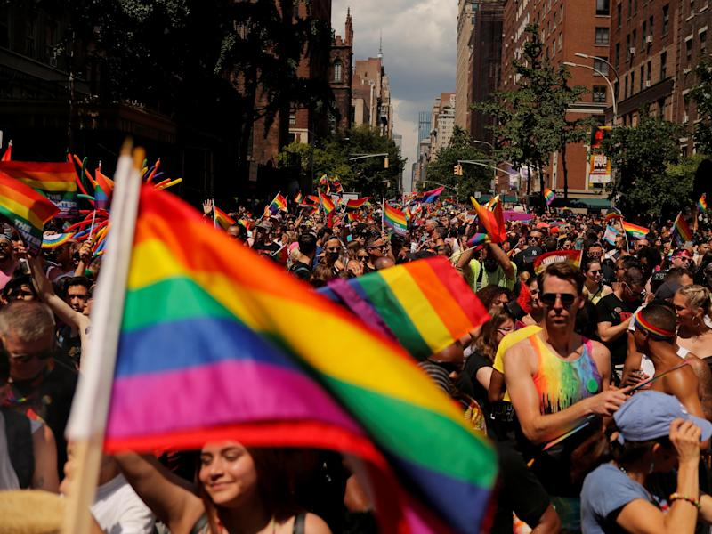 Marchers walk down 5th Avenue as they part in the 2019 World Pride NYC and Stonewall 50th LGBTQ Pride Parade in New York, U.S., June 30, 2019. REUTERS/Lucas Jackson