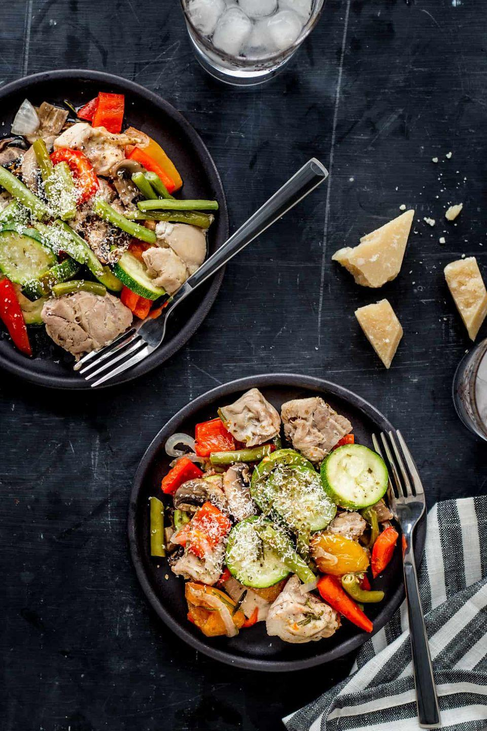 """<p>This chicken and veggie dish by<a href=""""https://helloglow.co/italian-chicken-veggie-foil-packs/"""" rel=""""nofollow noopener"""" target=""""_blank"""" data-ylk=""""slk:Hello Glow"""" class=""""link rapid-noclick-resp""""> Hello Glow</a> is low in carbs (it's keto-approved) and high in antioxidant-rich veggies like mushrooms, bell peppers, tomatoes, onion, and zucchini. These veggies also have high water content, which is great for reducing bloating and making it easier to lose weight.</p>"""