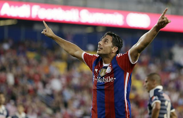 Bayern Munich's Claudio Pizarro celebrates after scoring a goal on Chivas during the first half of an international friendly soccer match at Red Bull Arena, Thursday, July 31, 2014, in Harrison, N.J. (AP Photo/Julio Cortez)
