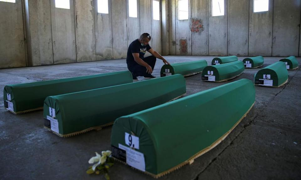 Coffins containing remains of newly identified victims before their burial
